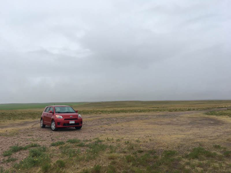 My lonely car amid the fields